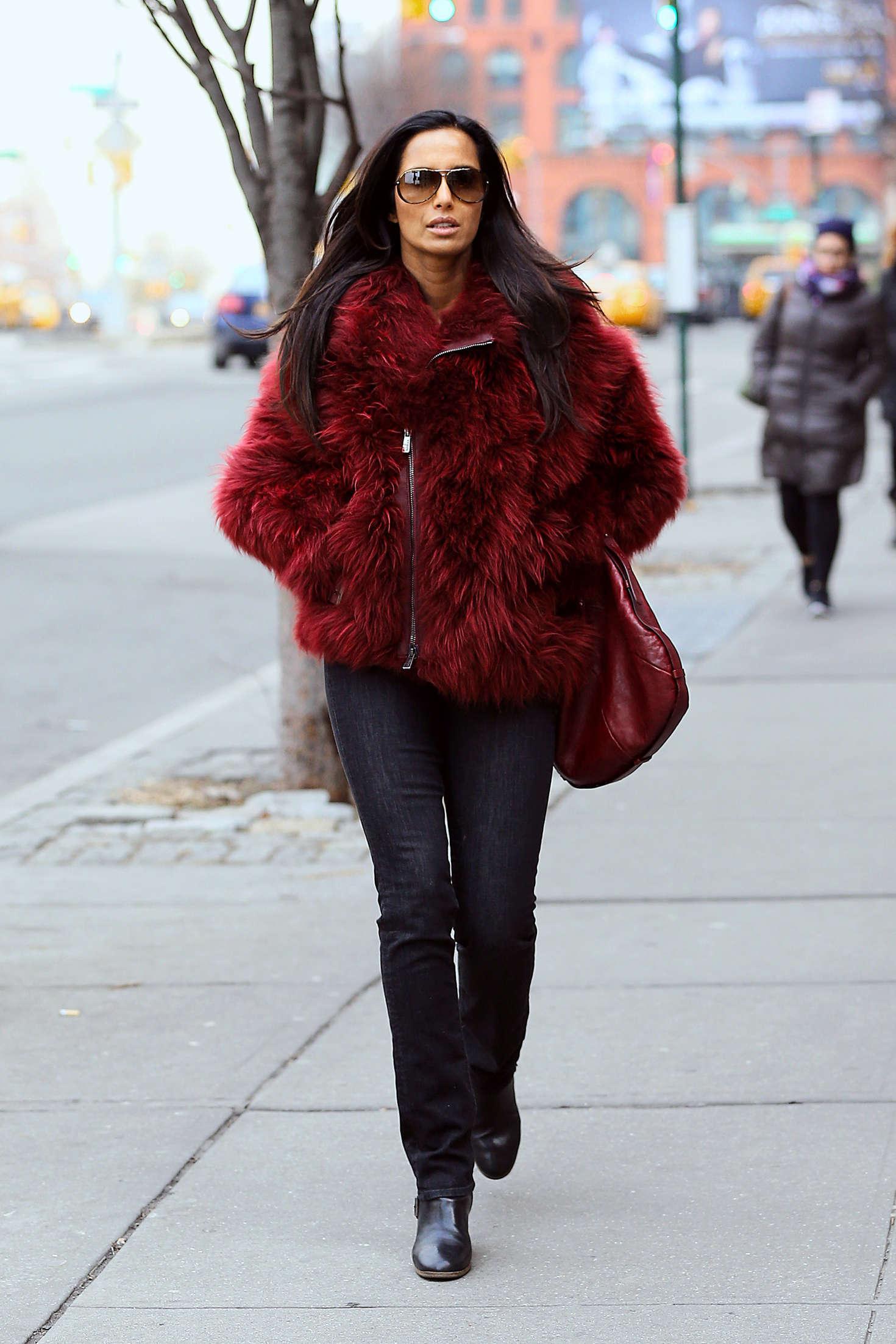 Padma Lakshmi in red fur coat out in New York