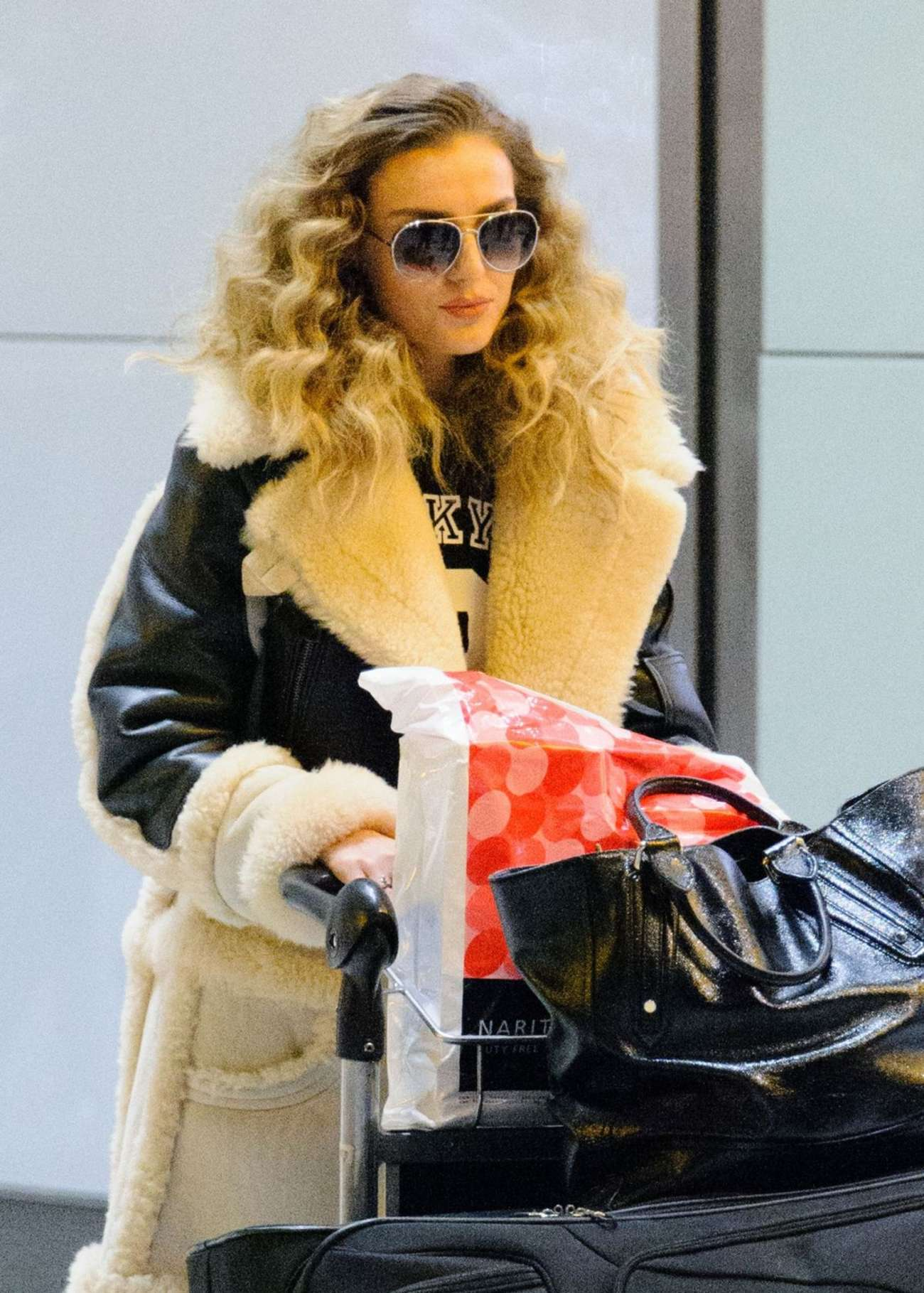 Perrie Edwards at Heathrow Airport in London